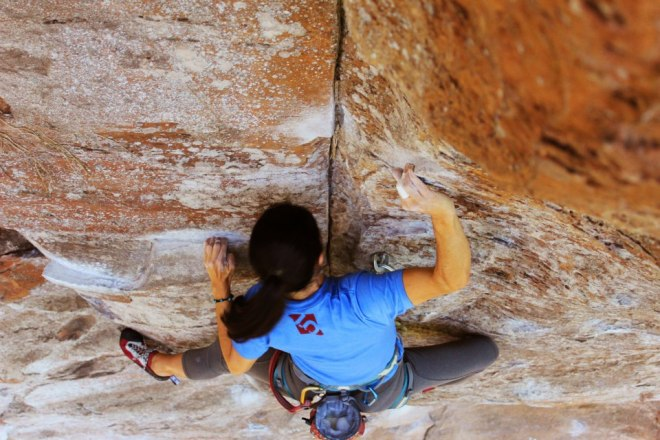 Strong Brazilian Climber Ana Lígia, climbing on some solid Sandstone at Itaqueri - SP
